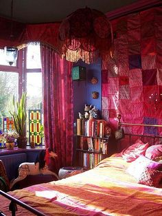 love the stained glass, patchwork wall hanging, and fabric umbrella pendant lamp in this bohemian bedroom