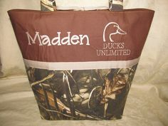 handmade custom max4 hd camo camouflage tan ducks unlimited inspired diaper bag, baby bag, tote bag, you choose name. $49.99, via Etsy.husband will carry this bag