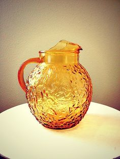 My grandma had one.  I remember drinking lemonade out of it.    Vintage Retro Amber Pitcher by Anchor Hocking by MidwestMilkGlass.