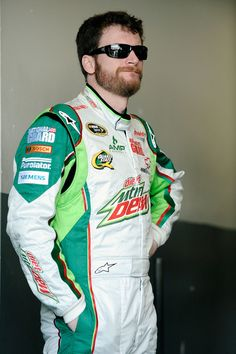 Dale Earnhardt Jr., driver of the #88 Diet Mountain Dew/National Guard Chevrolet, stands in the garage during practice for the NASCAR Sprint Cup Series Daytona 500 at Daytona International Speedway on February 22, 2012 in Daytona Beach, Florida.