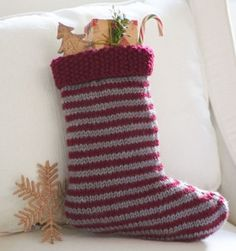 Striped Stocking   AllFreeKnitting.com This knitted stocking pattern will fit all of your candy canes and Christmas cookies. Fill this classic Striped Stocking with little treasures and stocking stuffers.
