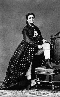 Occupation. Tart. Prostitute props one foot on the seat of a chair revealing her garter and underclothing. ca. 1865, Vienna, Austro-Hungarian Empire ---  Image by © Austrian Archives/CORBIS © Corbis. All Rights Reserved.
