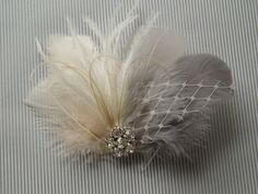 Wedding Bridal Hair Accessories Bride Feather Fascinator, Feather Hair Piece, ivory, grey, feather hair clip gray. $38.00, via Etsy.
