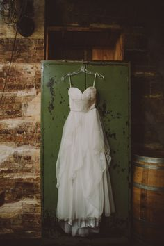 Love, Yu wedding dress - Jenny // photo by Chellise Michael // http://ruffledblog.com/elegant-brooklyn-winery-wedding