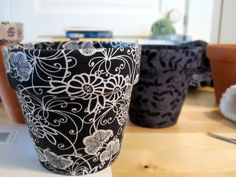 Cover clay flowerpots in fabric!