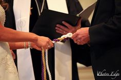 God's Knot - Cord of Three Strands  We have chosen to allow God to be at the center of our marriage, woven into every aspect.  The gold strand represents God  The purple strand represents the groom  The white strand represents the bride @Kat Kundmueller