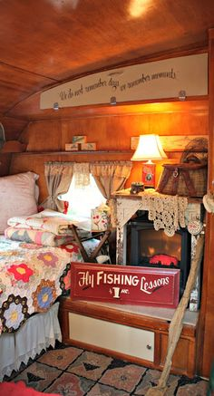 "the interior of an older camper - love the way it's decorated and even a ""fireplace"""