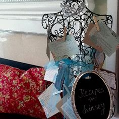 Favorite recipes to share with the bride displayed on dress form at shower.
