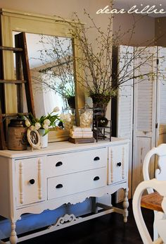 Love this old dresser that is now a sideboard for a dining room.  Notice the old window and folding doors.  Beautiful style!