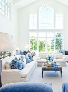 Chic blue and white living room. Love the large windows.