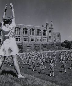 WAVES do exercises on the lawn of Hunter College, which was used at the Navy's boot camp for women during World War II ~