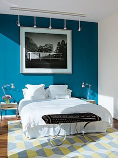 blue wall / white bed