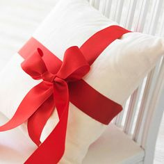 For an instant holiday touch, so simple to just wrap pillows with wide ribbon.