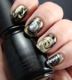 Gold and black marbled nail art manicure. Pinned for nails by www.SimpleNailArtTips.com