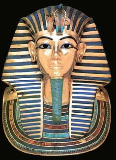 """Mask from King Tut's Mummy Case,  circa 1340 BCE.  Gold inlaid with enamel and semiprecious stones.  Height - 21 1/4""""."""