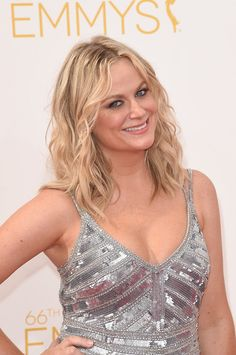 Amy Poehler looks fantastic in a low cut silver dress at Emmy's