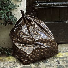 OH MY GOSH. Louis Vuitton garbage bags. I need these in my life! $15 per bag, but still...
