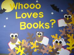 """Whoooo Loves Books?"" with owls and autumn leaves is a cute idea for an autumn reading bulletin board display."