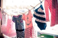 Nautical baby shower decor // hanging baby clothes