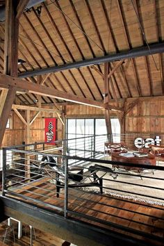 Steel tension rods and pipes reinforce the roof, and a steel beam helps hold up the master suite. Cable railing echoes the lines of the barn wood and metal alike. | Photo: James Yochum
