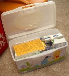 First Aid Kit in Wet Wipe Box for Traveling and in classroom!  This will be perfect for in our cars too....we were just saying we needed to do this