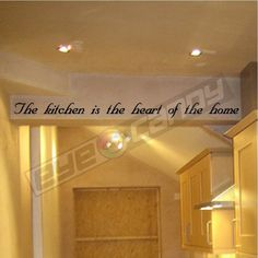 The kitchen is the...Wall Quotes Sayings Words Lettering Decals
