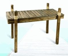 """Wooden Dock Table ~ This Wooden Dock Table is classically stylish.  It measures 47"""" x 23.6"""" x 34"""". You can use it indoors, outdoors, or on your boat.  It's very easy to assemble with two bolts per leg, and ships in 5 pieces.  The Nautical Dock table can be the center of attraction when you host parties, or are looking for a fun piece of Nautical Decor to liven up the home or yard."""