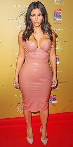 """KIM KARDASHIAN WEST Oh, you didn't know Kim had a new perfume out? Consider this corset dress she wears to the """"Fleur Fatale"""" launch in Melbourne, Australia a super-shiny indication that we're in for many more skintight promo tour outfits in the near future."""