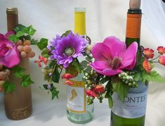 Decorate wine bottles with flowers fro centerpiece