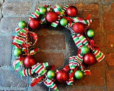 grapevine wreath, ribbon in different sizes, wooden letter, paint, glitter, ornaments, glue gun=front door cuteness!