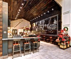 The Starbucks Store at St. Catherine Street and Greene Avenue in Montreal incorporates local recycled and reclaimed materials, including the rustic wood on the walls, ceiling and bar. starbuck store, starbucks cafe, starbucks stores, ceilings, starbucks store design, café starbuck, rustic wood