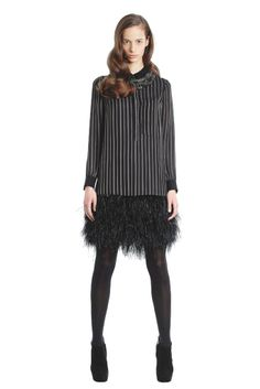 Haute Hippie silk and ostrich feather dress and necklace; Hue tights; Guiseppe Zanotti boots [Photo by George Chinsee]