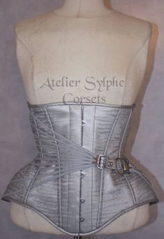 Atelier Sylphe Silver Grey PVC underbust boned cinched corset with chrome buckles and fan lacing