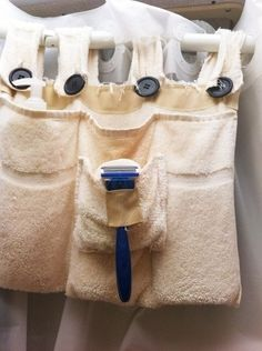 Make a towel caddy that you can hang off the shower curtain rod.   44 Cheap And Easy Ways To Organize Your RV/Camper