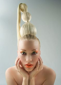 hair is in the shape that a hennin might be in!! who would actually wear their hair like this?!