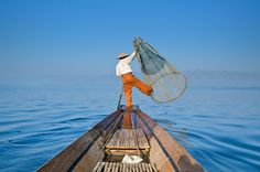 It's always a balancing act on Inle Lake, #Myanmar. #Burma #travel #AdventureHoney