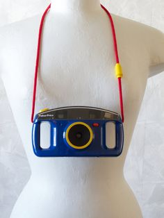Fisher Price Toy Camera circa 1990s. This camera uses 110 film which can still be purchased. I had one and left it at sea world :(