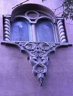 Beautiful exterior purple window treatment