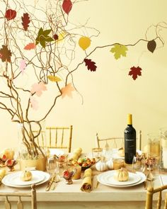 Thankful Tree... A sweet centerpiece perfect for teaching kids what Thanksgiving is really about. To make it, get branches from your yard or local florist (I used curly willow) and cut paper leaves from construction paper. You'll just need a small piece of double stick tape to attach the foliage to your branches. Have family and friends write thankful notes on the leaves.