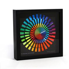 With its playful kaleidoscope of color, this clock (handmade right here in California) would make the perfect gift for dads and grads. TGTTY