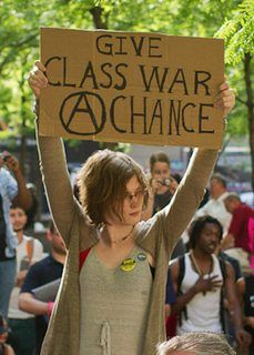 Photo of Justine Tunney holding up a sign that says Give Class War A Chance: Justine-president and co-founder of OSN, software engineer at google