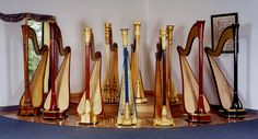 Panorama of harps made or restored by H. Bryan & Company. Four of the harps are new, built on the Camac system. The Ram's head is an Erat; there is a Salvi, John Egan, a Wurlitzer CC, an L 17, and an Erard Gothic.