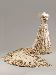 Indian-embroidered evening gown,  Worth, ca. 1900-03. Silk with silver and gold thread and bullion work. Three pieces (bodice, skirt, train).
