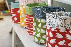 Round bottomed fabric storage buckets – a tutorial by Film in the Fridge.  I made these to give / wrap christmas gifts