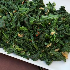 Calabrese Mustard Greens | Just a little red wine vinegar transforms this otherwise familiar bowl of garlicky greens.