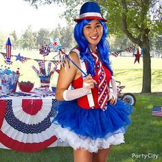 Strut your stuff in red, white and blue! Glam up as Miss Independence with a blue wig, patriotic fedora and stars-and-stripes necktie. Now that's an all-American babe! blue wig