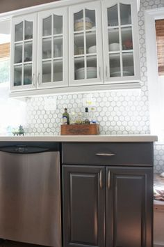 Two-Tone Gray and White Kitchen Makeover | LoveLee Homemaker featured on Remodelaholic.com #paintedcabinets #grayandwhite #kitchenmakeover