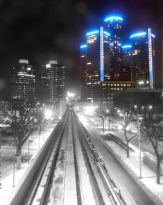 Downtown Detroit looking at GM's RenCen building off to the right in the background from the Detroit People Mover tracks.