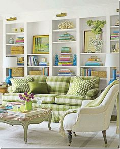 Artfully done shelves and color keeps your eyes traveling around this room. decor, bookshelf styling, living rooms, couch, color, bookcase styling, hous, shelv, buffalo check