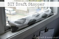 Cute DIY Draft Stopper. These things work wonders for the cold winter days (and energy bills!) | How Does She...